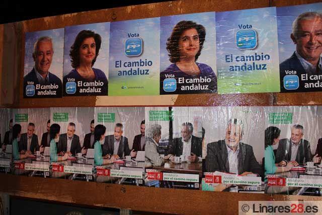 Los partidos hacen su particular pegada de carteles en Linares