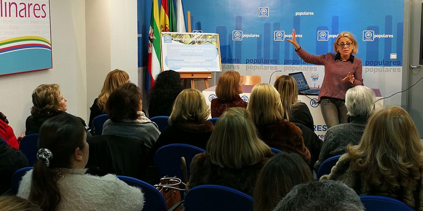Conferencia sobre los beneficios del AOVE frente al cáncer en la sede del PP de Linares
